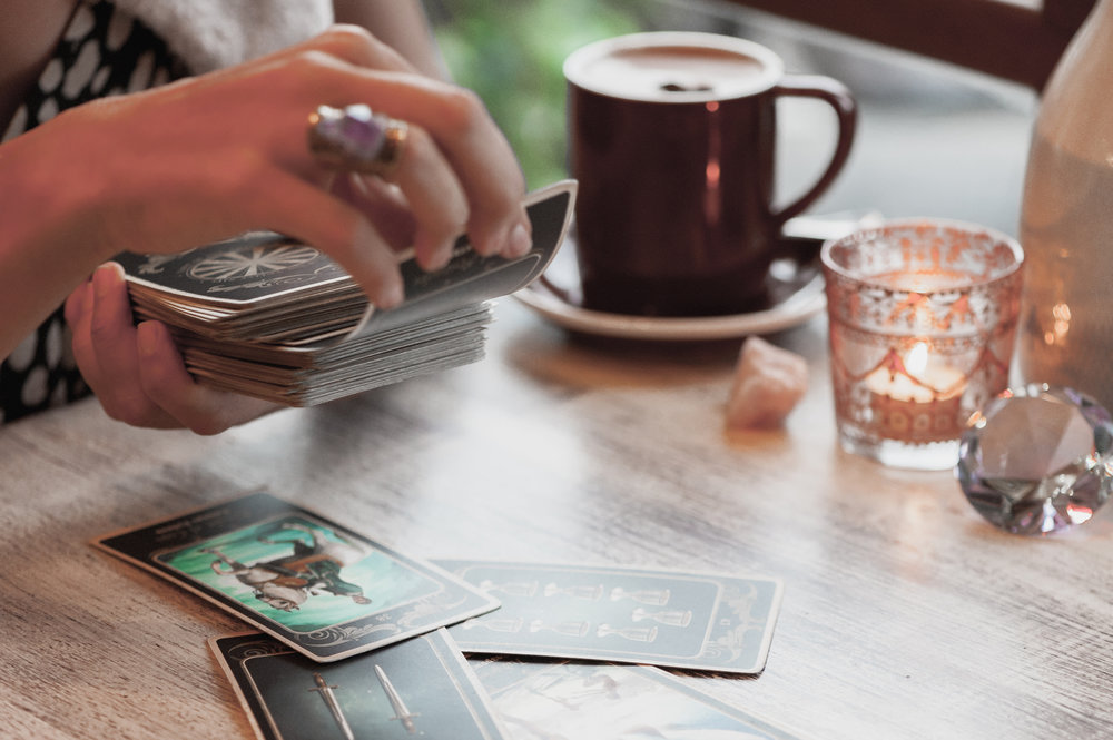 What makes the difference between a card reading and a card interpretation?